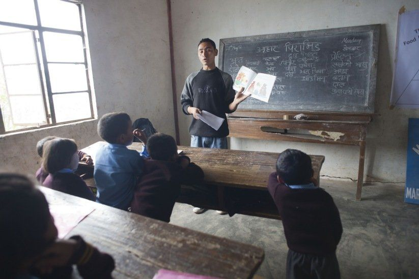 Community Health Worker in Indian Classroom